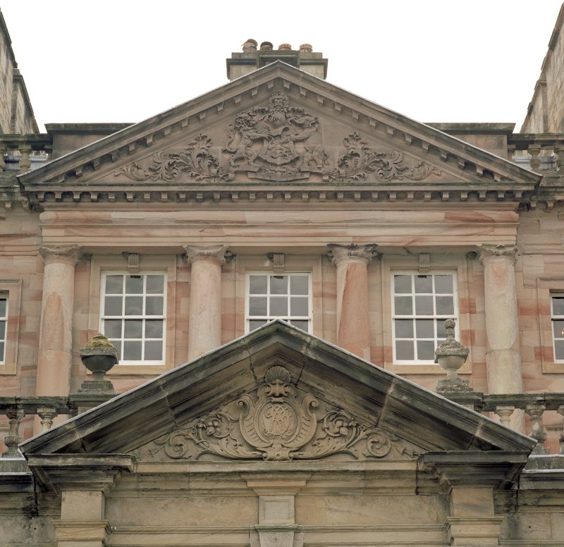 Detail of pediments on N front and above N doorway