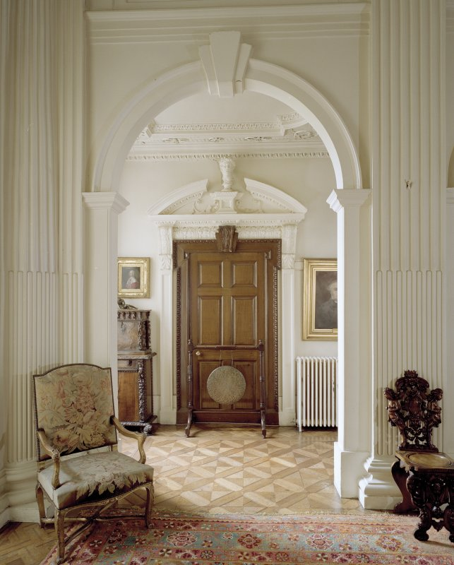 Ground floor hall of Arniston House, Midlothian, centred on arch and doorway in NE corner