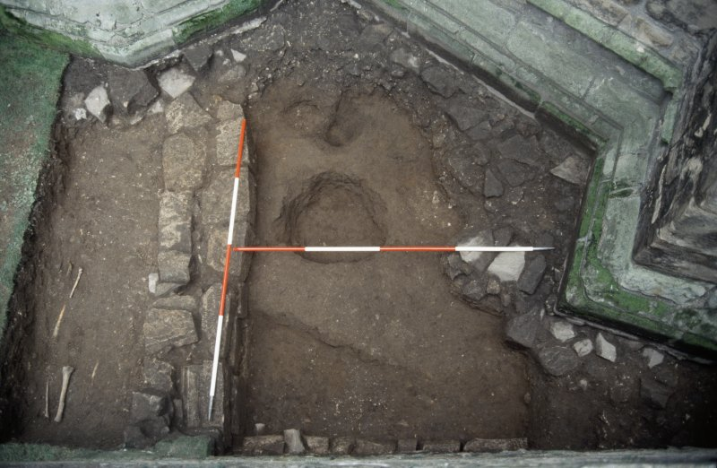 Excavation photographs: Trench 1, showing charnel pit and wall F005. From S at Elgin, Cathedral.