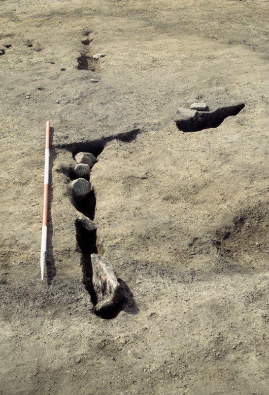 Excavation photographs: Slot [163] showing stone packing.