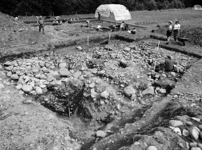 Excavation photograph: Black and White Negative CAW88-668; 1988 season at Cawdor (Easter Galcantray). General view of corner tower and excavated enclosure ditch section.