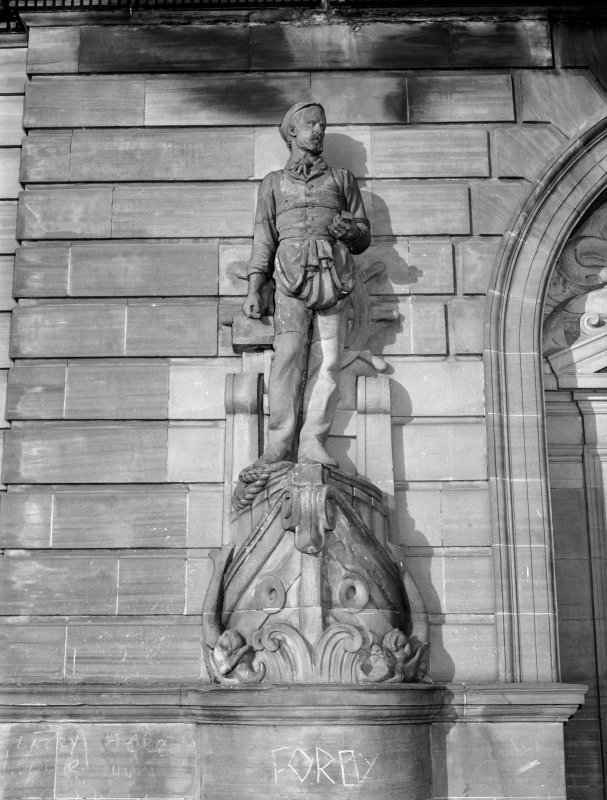Glasgow, 1030-1048 Govan Road, Shipyard Offices Detail of statuary on principal facade. Life size figure of a man standing on the bow of ship holding ship building tools.