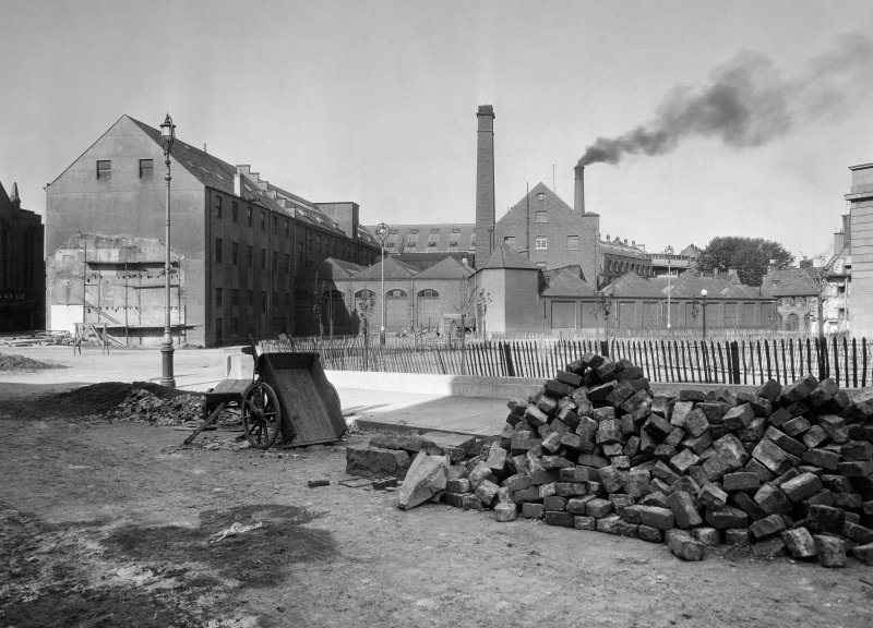 Perth, Pullar's Dyeworks. General view of dyeworks, East end of Mill Street and Castle Gable, with street cobbling in progress in foreground.