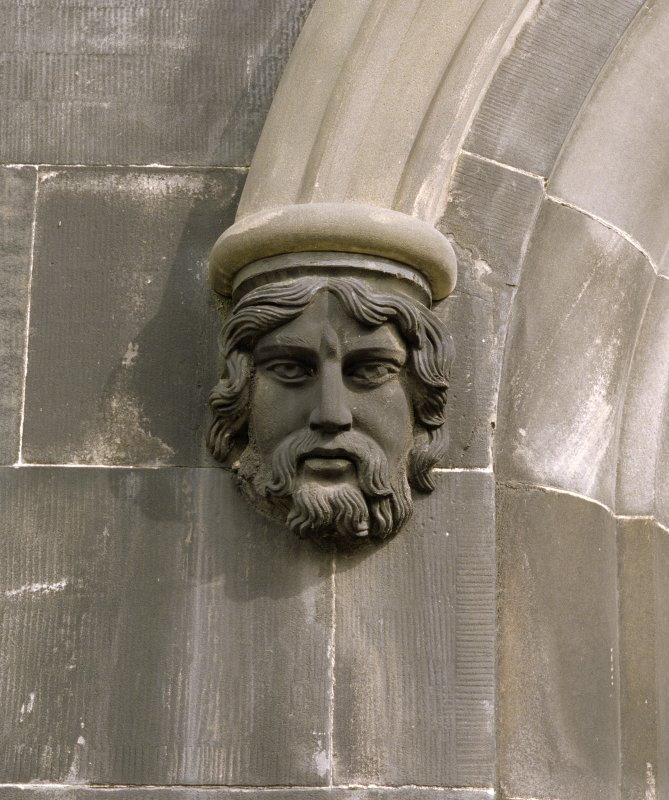 Ground floor, west window, detail of corbel head