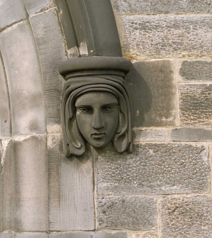 Ground floor, south window, detail of corbel head