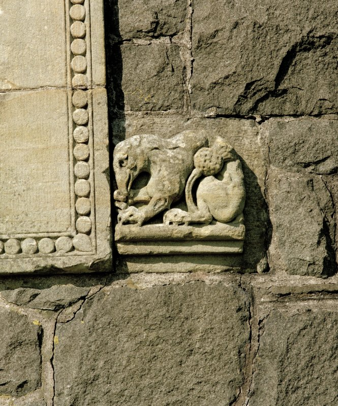 Detail of zoomorphic figure on right side of doorway
