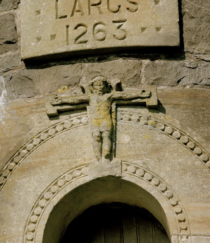 Detail of carving of crucifixion at head of doorway