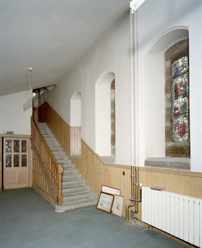 Interior. View of entrance lobby with gallery stairs