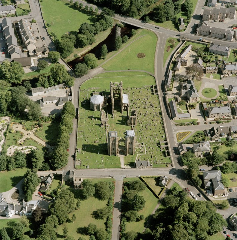 Digital copy of oblique aerial view centred on the remains of the cathedral and Chapter House, taken from the W.