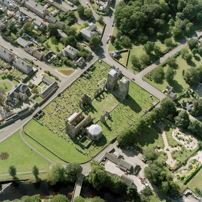 Digital copy of oblique aerial view centred on the remains of the cathedral and Chapter House, taken from the NE.