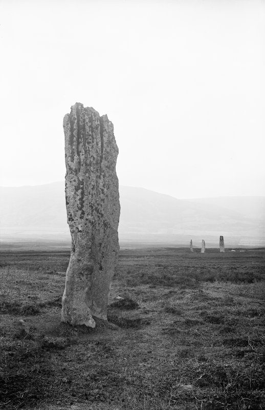 View of standing stone with three others in the distance, Machrie Moor, Arran. Photographed by Erskine Beveridge in 1884.