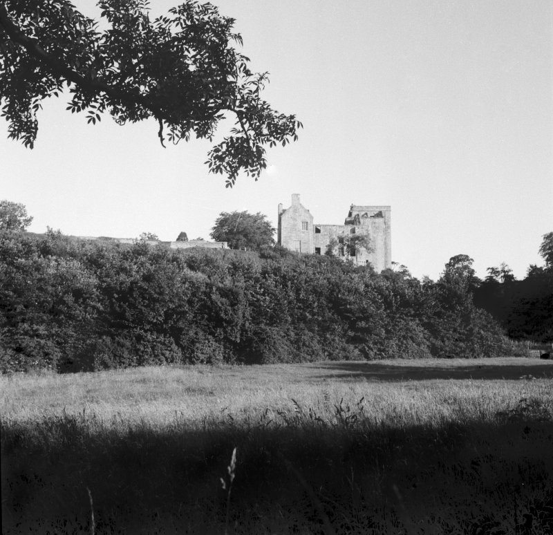 Distant view across meadows from N.