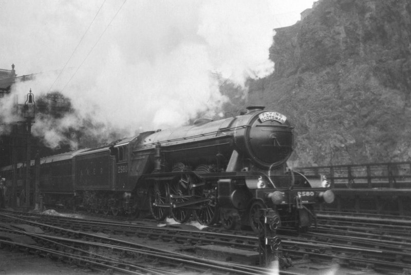 View of A3 4-6-2 locomotive 2580 'Shotover' pulling the 'Flying Scotsman' service out of Waverley Station. PHOTOGRAPH ALBUM NO 52: THE EMPIRE EXHIBITION ALBUM. Page 17.