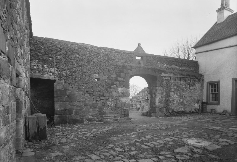 Glasgow, Auchinlea Road, Provan Hall. General view of wall and stair in courtyard.