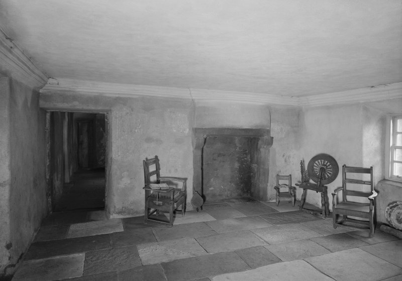 Glasgow, Auchinlea Road, Provan Hall, interior. View of fireplace, with chairs and spinning wheel.