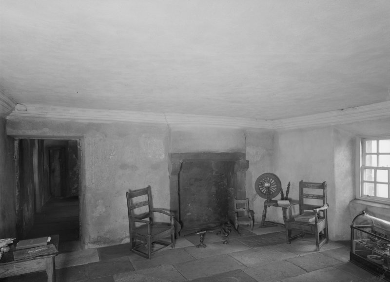 Glasgow, Auchinlea Road, Provan Hall, interior. View of fireplace with chairs and spinning wheel.