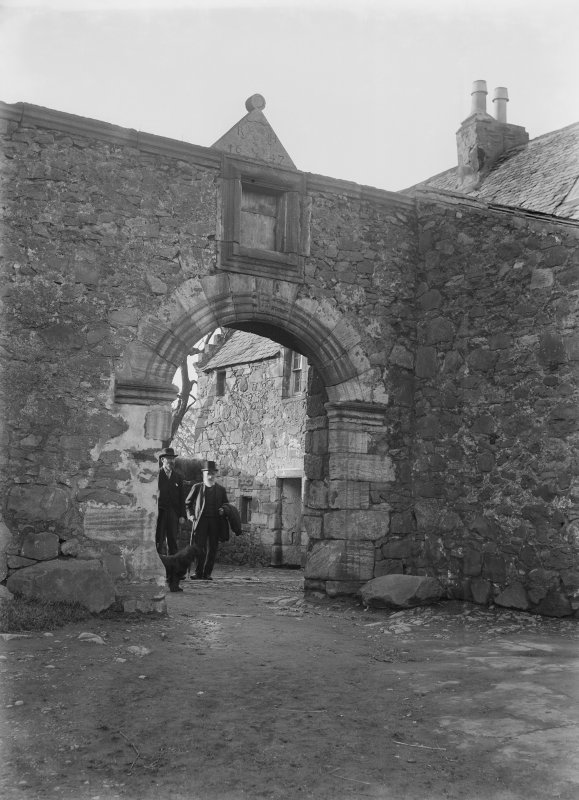 Glasgow, Auchinlea Road, Provan Hall. View of entrance with two gentlemen emerging from courtyard.