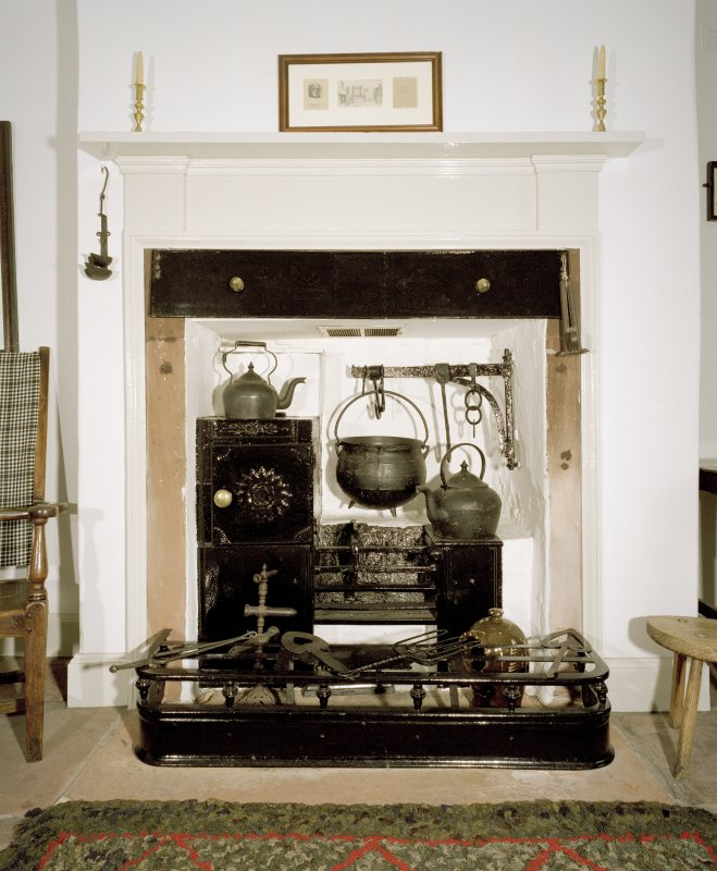 Interior. Ground floor, S room, detail of fireplace
