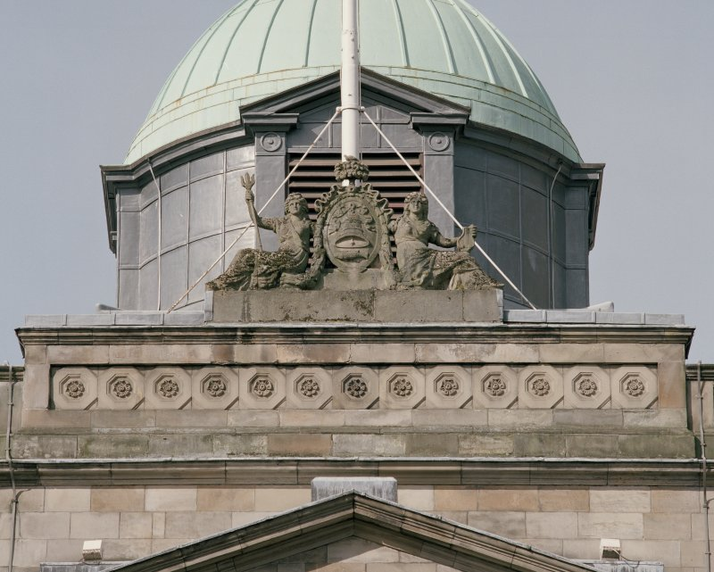 Detail of carved figures and coat of arms above central bay on south front