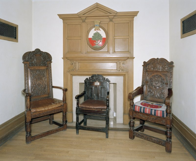 Interior, ground floor, reception room, view of fireplace and oak chairs