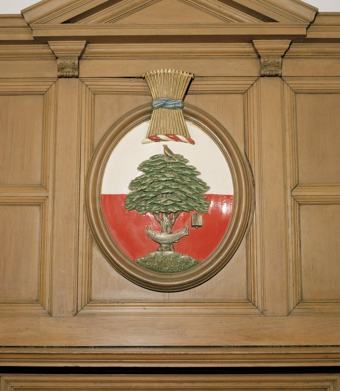 Interior, ground floor, reception room, detail of coat of arms on fireplace