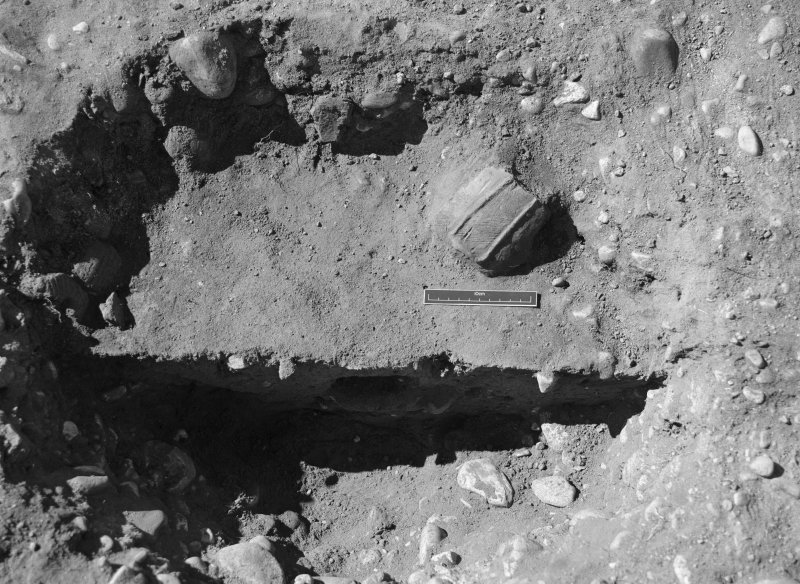 Excavation photograph: Film 96/BW/2: Feature L23: W half under excavation showing pottery at Littleour. Illustration 93.