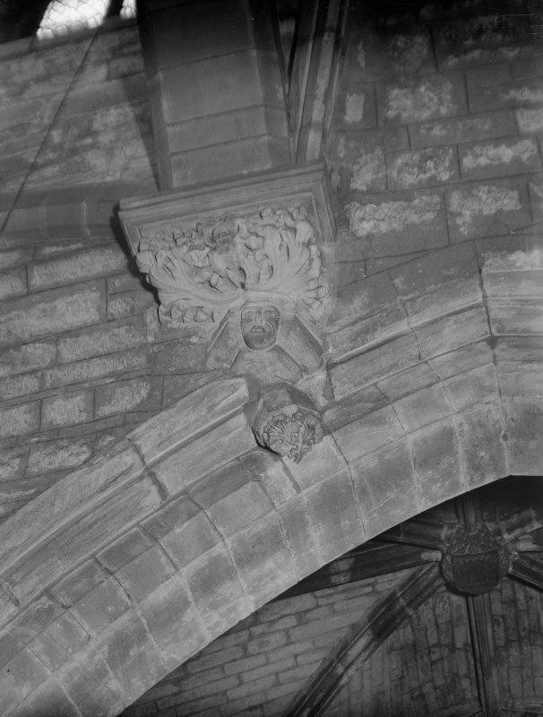 Interior-detail of carved corbel in South Transept at West end of South aisle of Choir
