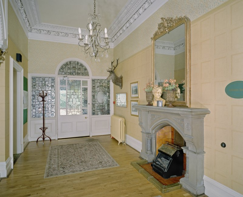 Interior. Ground floor. Main entrance hall showing entrance screen and fireplace
