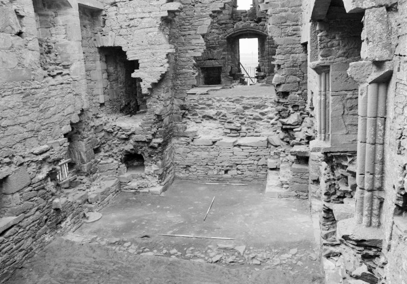 Excavation photograph: Film 8, Frame 34 - View from the east into the first-floor hall of the tower house, with the ground-level kitchen in the foreground. Note the oven on the south side of the kitchen fireplace. From the 1994 season excavation at Melgund Castle. Illustration 6 in publication.
