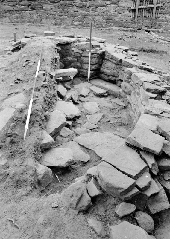 Excavation photograph: Film 10, Frame 12 - Structure F308 with floor exposed on east side. View from the south. From the 1996 season excavation at Melgund Castle.