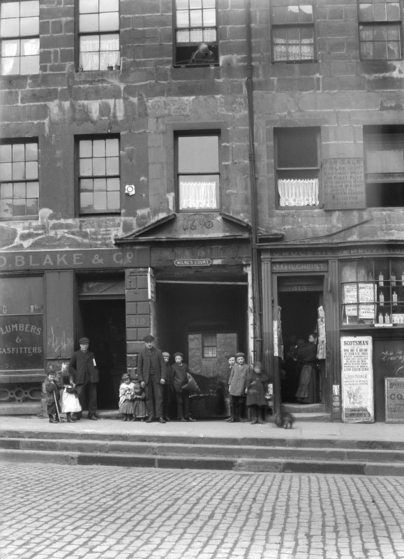 General view of entrance to Milne's Court, Edinburgh, on Lawnmarket elevation, with D Blake & Co and J Gilchrist Groceries & Provisions.
