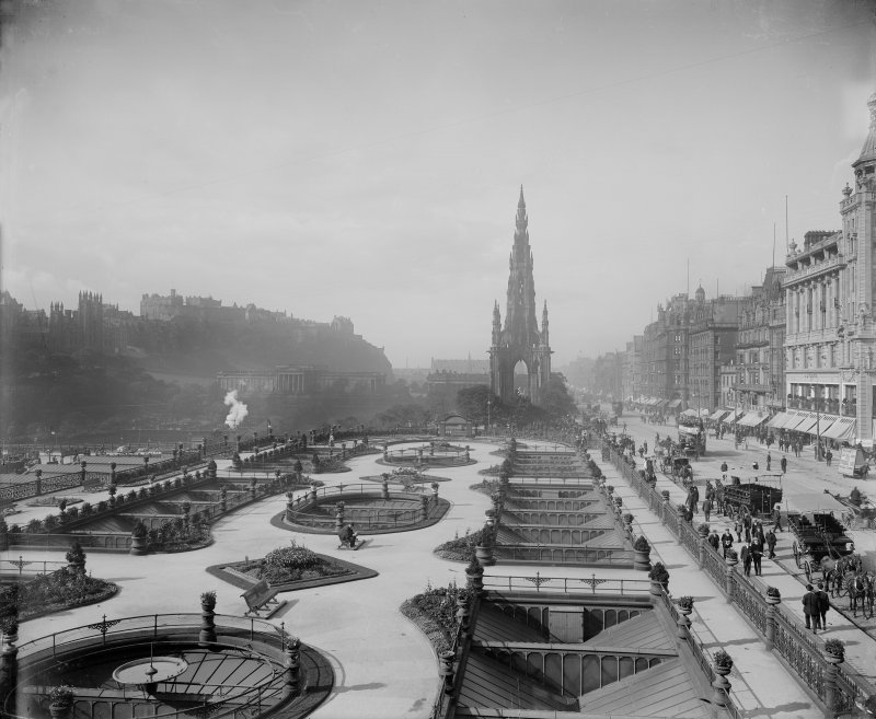 General view of Princes Street looking westwards showing the Castle, Mound, Scott Monument, Waverley Gardens and street with trams, pedestrians and horse drawn buses and carriages.