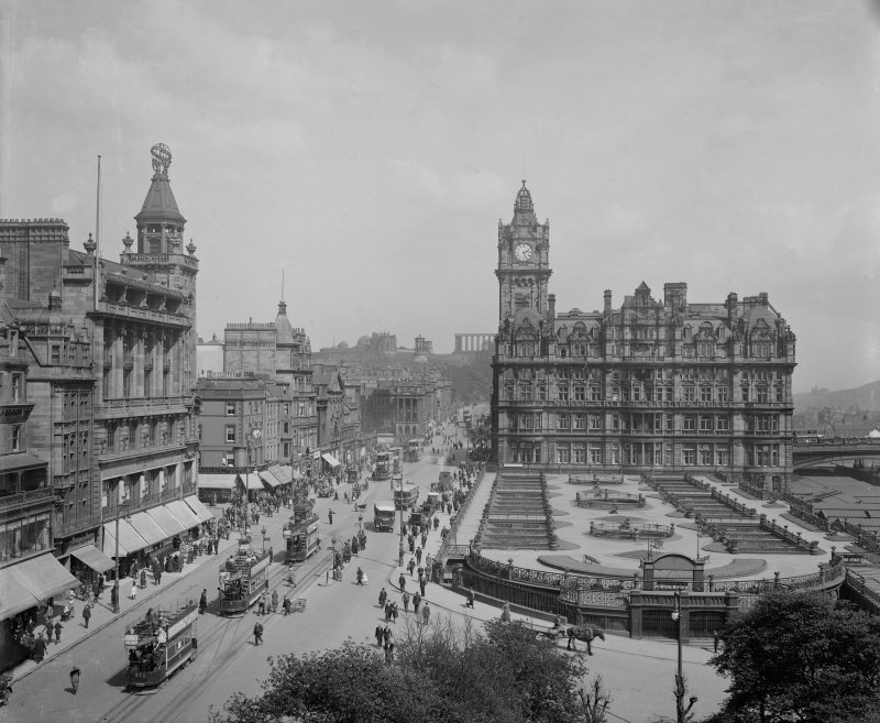 View from Scott Monument looking east towards Calton Hill showing the North British Hotel, Waverley Gardens and a busy Princes Street with shop awnings, pedestrians, trams, buses and horse and carts.