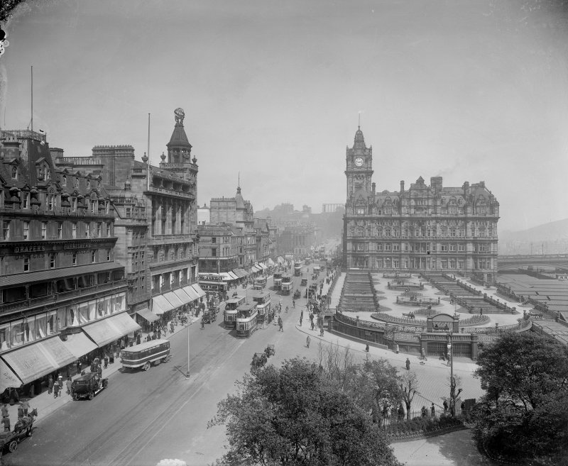 General view of Princes Street looking east towards Calton Hill from the Scott Monument showing Waverley Gardens, the North British Hotel and a busy street full of shoppers, trams and cars.