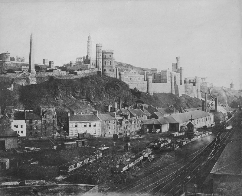 View of Calton Hill and Calton Jail, Edinburgh looking over railway tracks and coal wagons at the eastern entrance to Waverley Station.