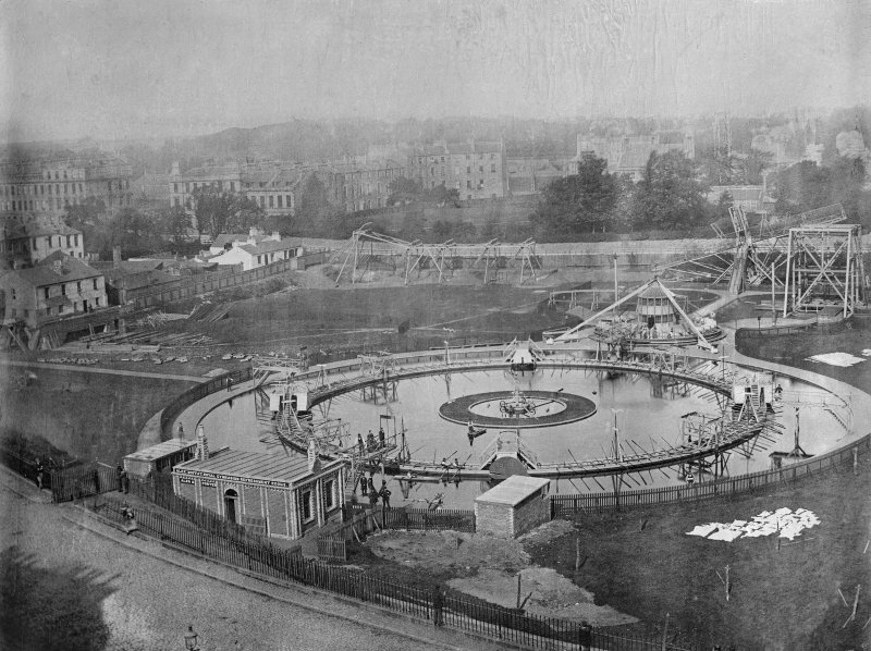 View of the Royal Patent Gymnasium in Royal Cresent Park, Edinburgh. It opened in 1865 but closed at the end of the century and was turned into a football ground. The circular device is a giant round  ...
