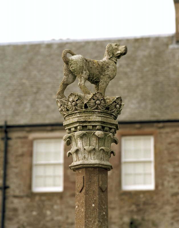 Detail of statue of dog and crown on top of fountain, Drummond Castle.