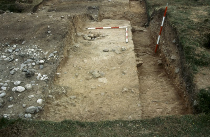 Excavation photographs: Film 68 from the 1996 season at Brown Caterthun. Trench 14: Rampart F, cobble layer, buried turf and posthole from the north-west.