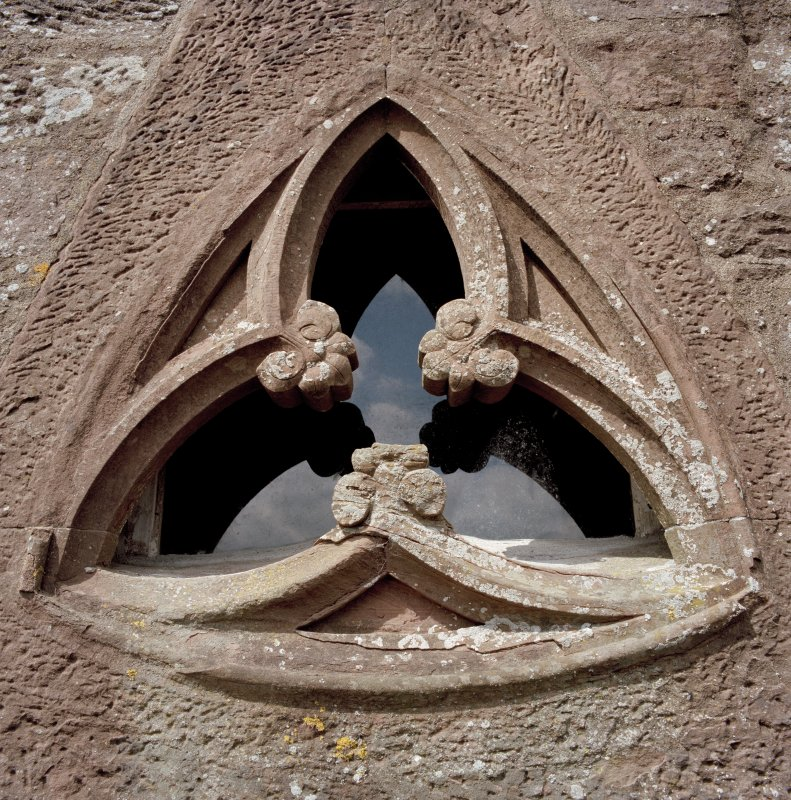 Detail of traceried window in South face of keep at parapet level.