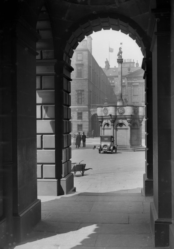 General view of Market Cross through arch in Parliament Square