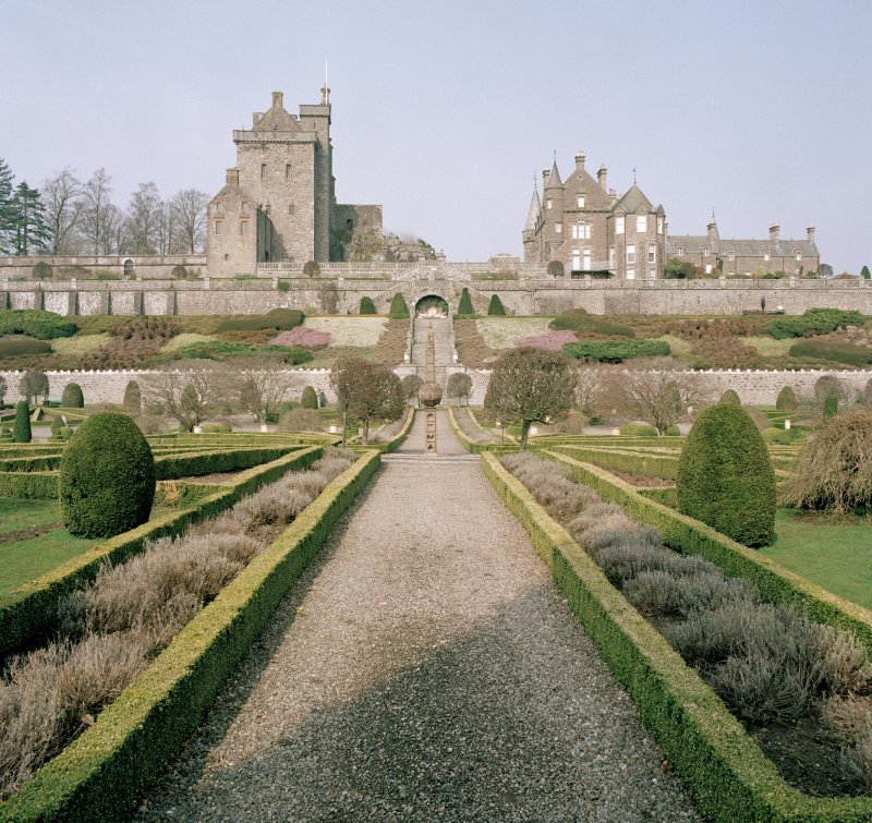 General view of keep, house and formal gardens with sundial from South.