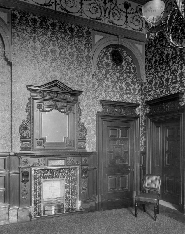 Interior-general view of meeting room showing patterned wallpaper, fireplace with mirror over and doorways