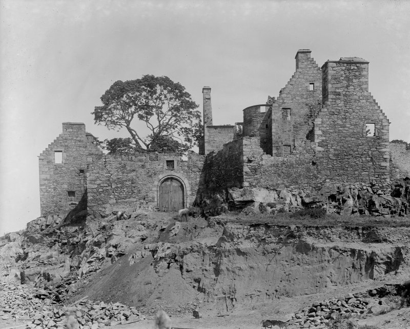 View of castle ruins and men digging