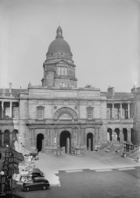 General view of Quadrangle looking East towards dome with cars parked at edge