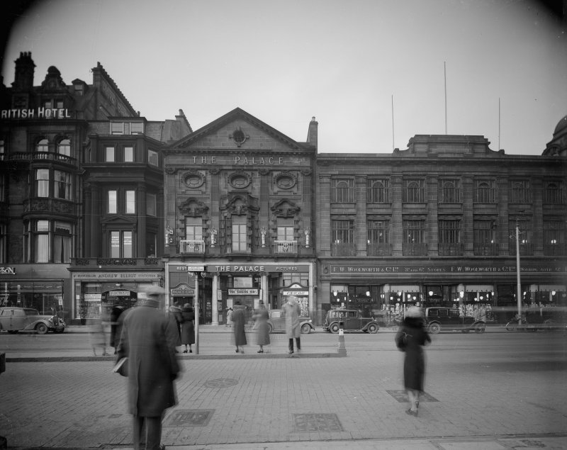 View of the Royal British Hotel, The Palace Cinema  and Woolworths (since demolished) on Princes Street, Edinburgh showing pedestrians and cars.