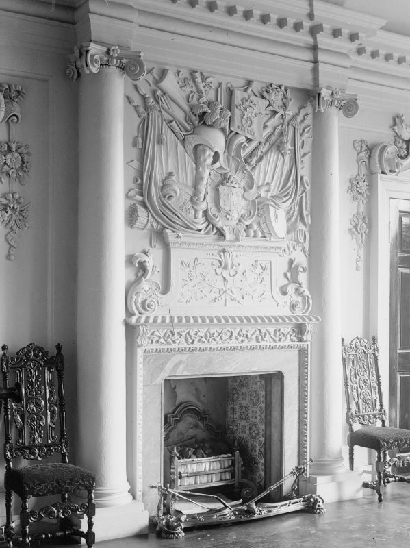 View of fireplace and overmantle in hall.