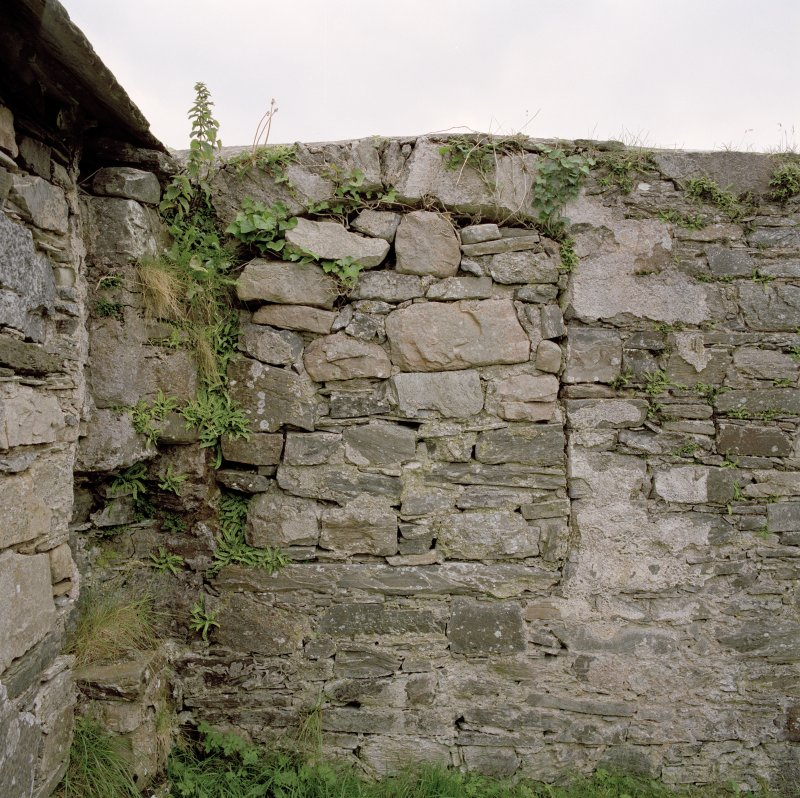 Interior, detail of blocked window in S wall of nave