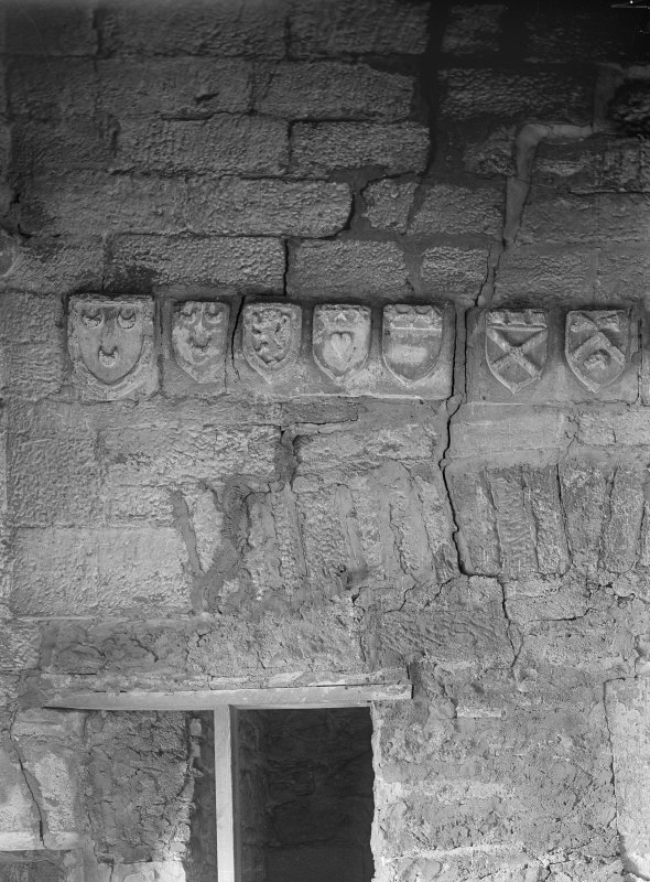 Interior. Detail of panels over fireplace.