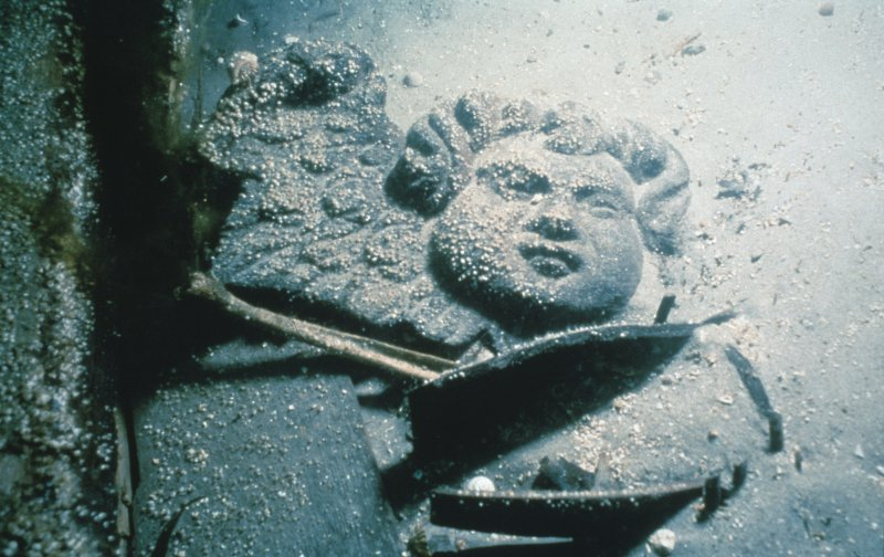 Maritime photographs: Wooden carved cherub in situ at the wreck off Duart Point during investigations by the Archaeological Diving Unit (ADU).
