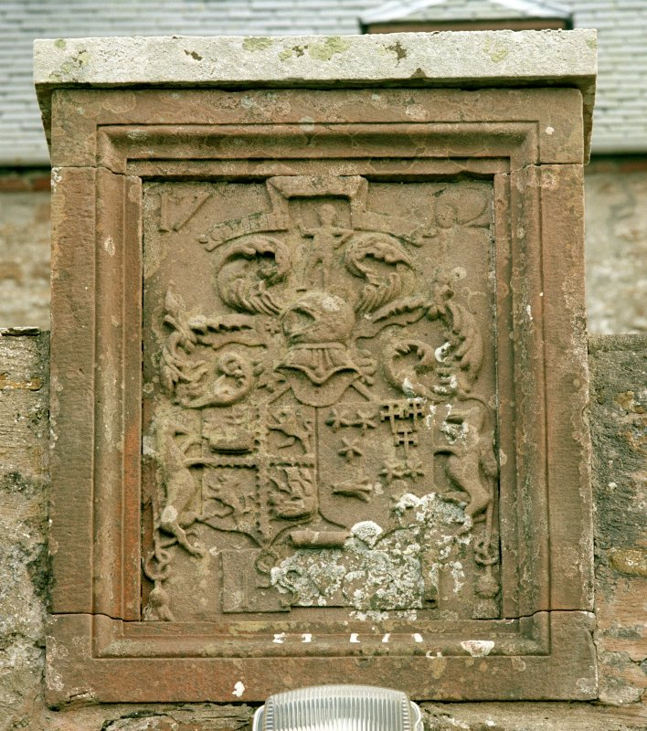 Detail of armorial panel above doorway to courtyard on north front
